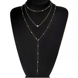 3/$15 3- silver layered necklaces brand new in pkg